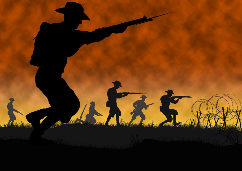Silhouette of Australian New Zealand ANZAC soldiers against the sky during battle.